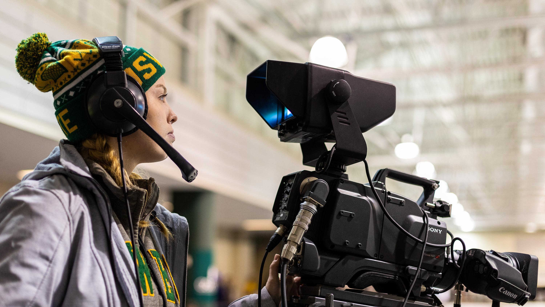 Tara O'Donovan operates a camera at an Oswego hockey game