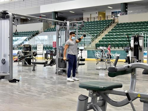 Students use the Fitness Centers relocated into Marano Campus Center arena
