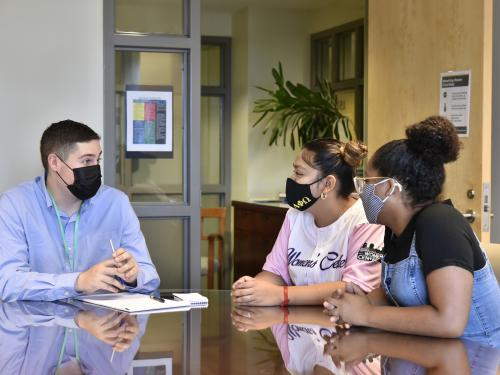 Advisement Center student guides having discussion in new office space