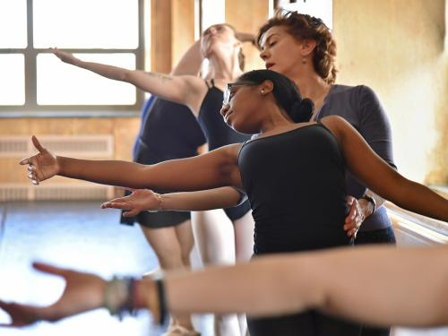 Ballet instructor Ligia Pinheiro helps student Marquia Williams fine-tune her positioning