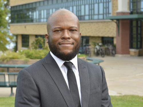 Dr. Isiah Brown stands outside Rich Hall, the college's School of Business