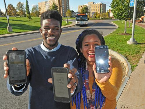Students show BusShare web app on their smartphones