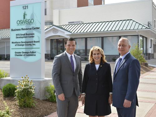 Oswego Mayor William J. Barlow Jr., SUNY Oswego President Deborah F. Stanley and Pathfinder Bank President Thomas W. Schneider, fronting the college's new Business Resource Center in Oswego