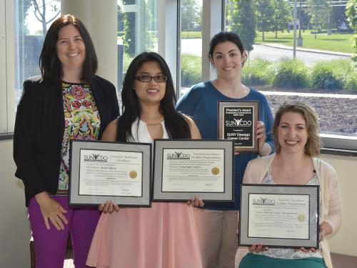 Career Services staff with awards