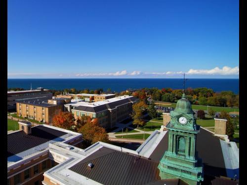 Aerial photo of SUNY Oswego campus overlooking Sheldon Hall