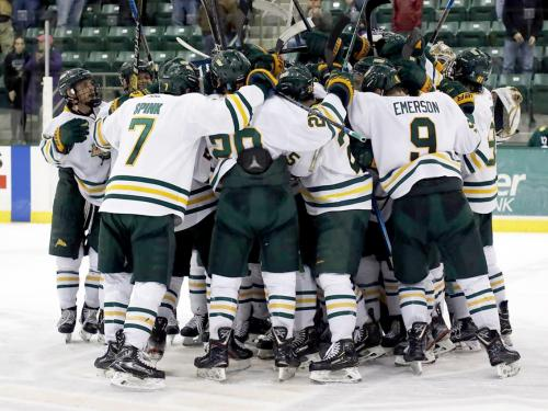 Laker men's hockey players celebrate