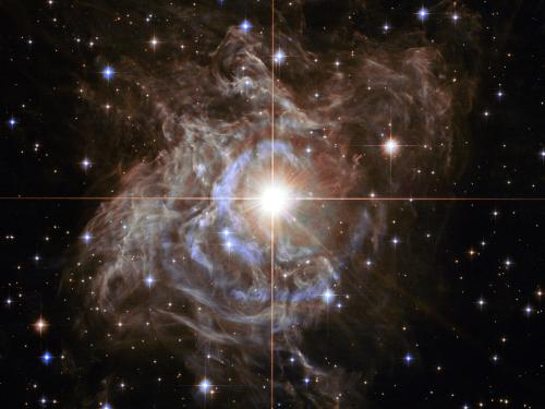 Scientists including SUNY Oswego's Shashi Kanbur use cepheid variable stars like the pulsating RS Puppis (pictured in this NASA image) to try to calculate the size of the universe.