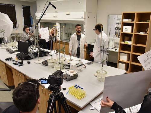 Students work on a film promoting lab safety