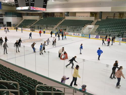 Young people ice skating in Marano Campus Center arena