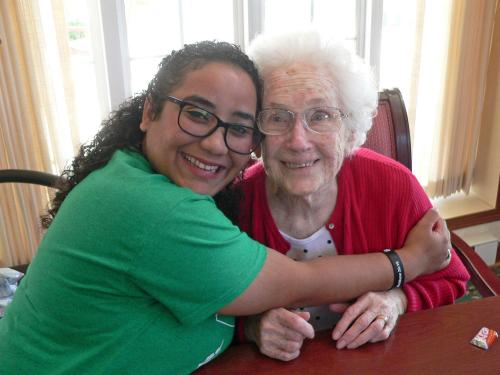 Oswego students doing English immersion program bonded with local Bishop's Commons seniors