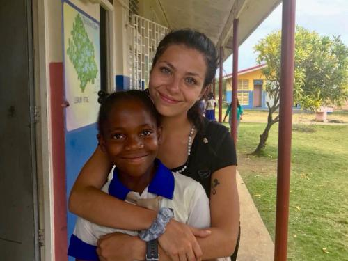 Isabella Falcigno hugs a Jamaican youth