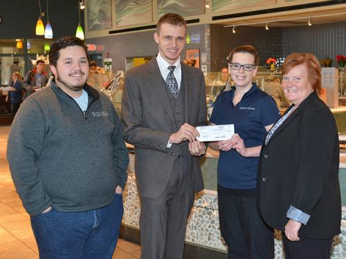 Organizers of Miss-A-Meal drive, Auxiliary Services staff pose with check