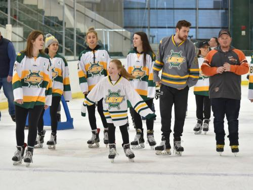 Laker hockey players skate with children