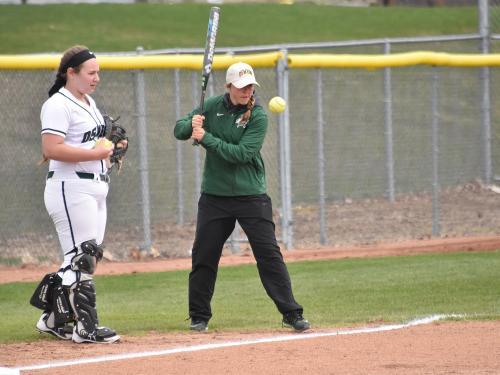 Graduate student Morgan Nandin teaching softball