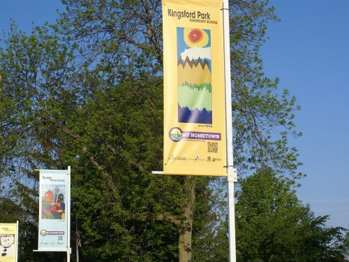 Banners featuring schoolchildren's art near Breitbeck Park