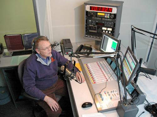 File photo of John Hurlbutt broadcasting from WRVO studios