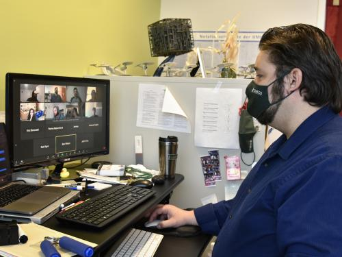 Bastian Tenbergen meets with his class virtually from his office in the Shineman Center