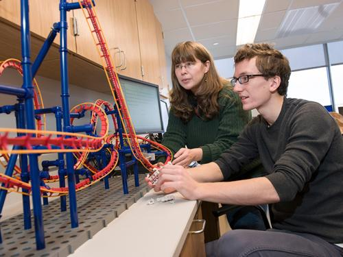 Professor Carolina Ilie and student working on physics of rollercoasters project