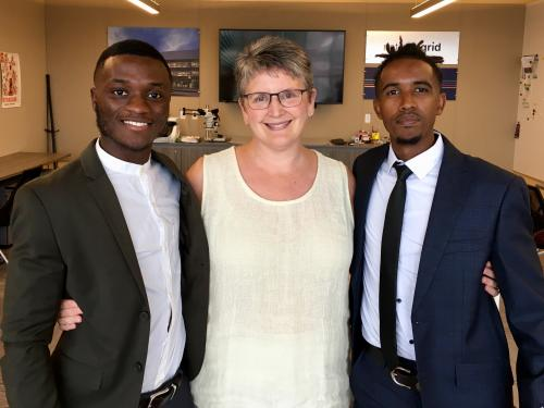 Sandra Bargainnier congratulates two of Oswego's Synergy interns
