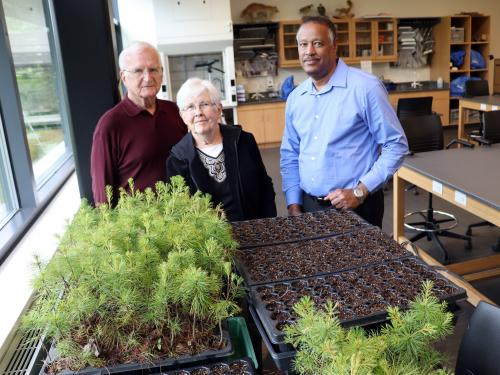 Arizona residents and New York state canal system boaters George and Jane Pauk join SUNY Oswego's Kamal Mohamed in a lab at Rice Creek Field Station