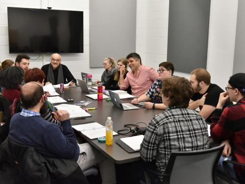 Cast and crew doing a pre-production group reading