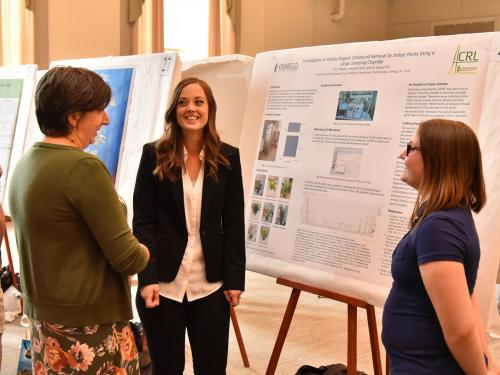 Julia Koeppe speaks with students Anna Makara and Maggie Miller about their research in analytical chemistry
