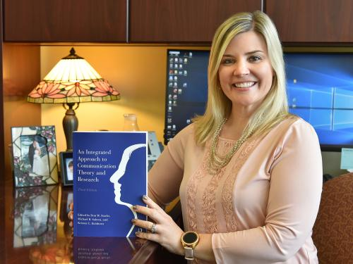Kristen Eichhorn with revised An Integrated Approach to Communication Theory and Research textbook