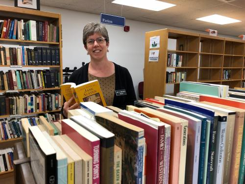 Sarah Weisman looks at books for Penfield Library book sale