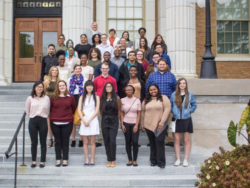 Students earning Marano Scholarships on steps of Sheldon Hall