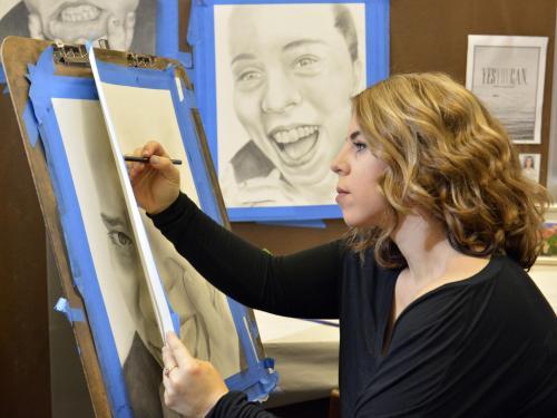 Jennifer Varvaro works on a self-portrait