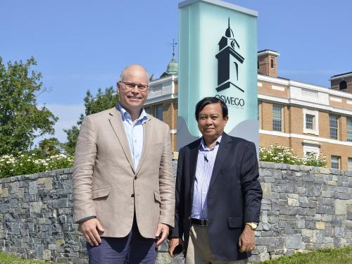 Dr. Joshua McKeown (left), director of SUNY Oswego's Office of International Education and Programs, mentors physician and educator Dr. Myint Oo, who recently traveled from Myanmar to learn more about fostering international education opportunities