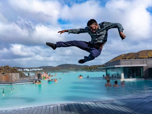 Mic Anthony jumps into the air near Blue Lagoon in Iceland