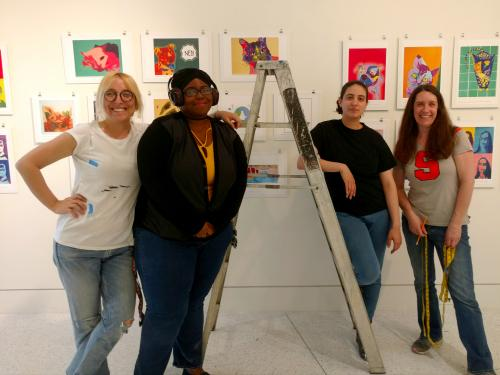 College students prep, hang variety of artwork by schoolchildren in gallery