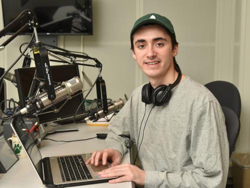 Snior journalism major Ryan Zalduondo in WRVO studios