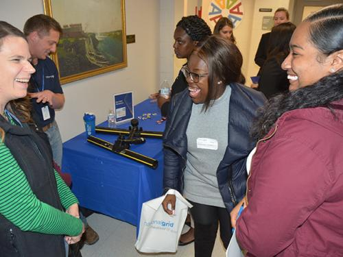 Holly Oyer, National Grid director of gas field operations in Central New York, talks with SUNY Oswego students Taylor Clark and Kariya Buckshot
