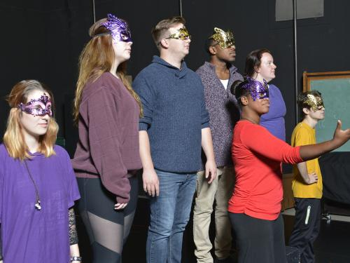 "Students in ""Acting Shakespeare"" class in masks and rehearsing"