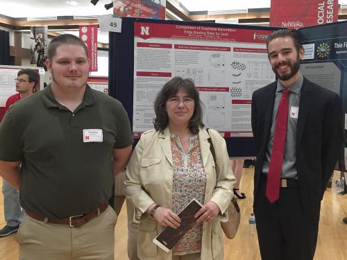 Benjamin Swanson, Carolie Ilie and Ian Evans with research poster