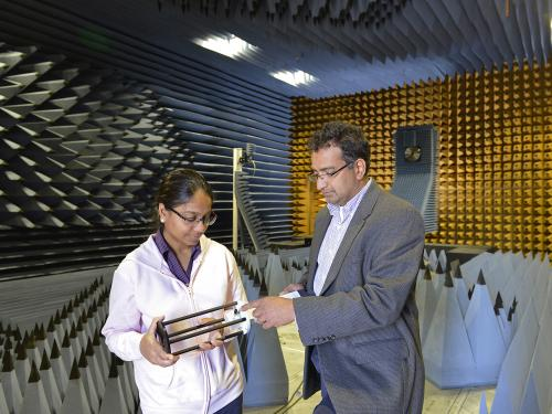 Pat Parimi in anechoic chamber working with Neha Keshan