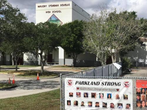 A memorial in front of Marjory Stoneman Douglas High School in Parkland, Florida