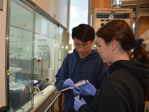 Physics undergraduates Trieu Le and Annika Neufeld-Kreider conducting research