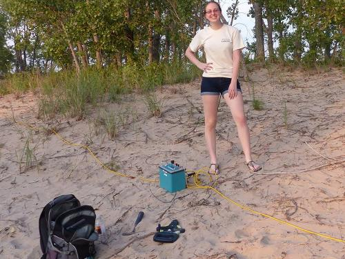 Kimberly Smith doing research on dunes by Lake Ontario