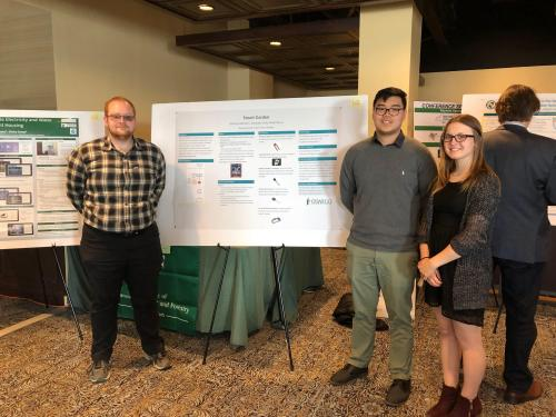 Student who created Smart Garden giving poster presentation