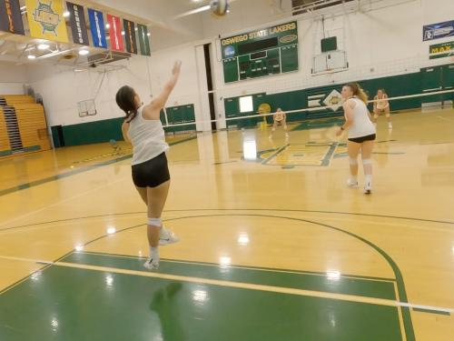 Skylar Bechard serves in a volleyball practice