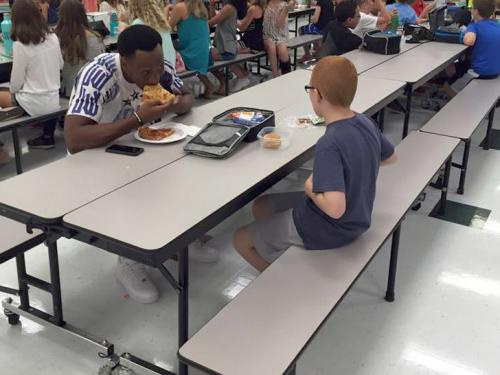 Florida State University football player Travis Rudolph chose to sit with a lone, autistic 11-year-old at lunch