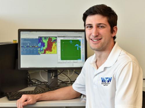 Zachary Hiris in a meteorology lab