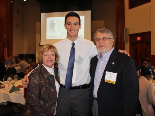 Srokas presenting scholarship to Oswego student