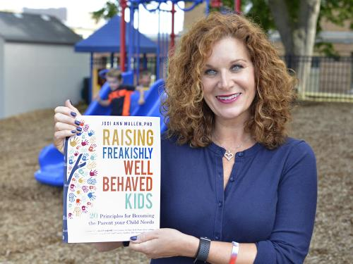Jodi Mullen with her book, Raising Freakishly Well Behaved Kids: 20 Principles for Becoming the Parent Your Child Needs