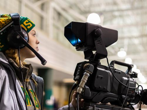Tara O'Donovan operates a camera at an Oswego hockey game