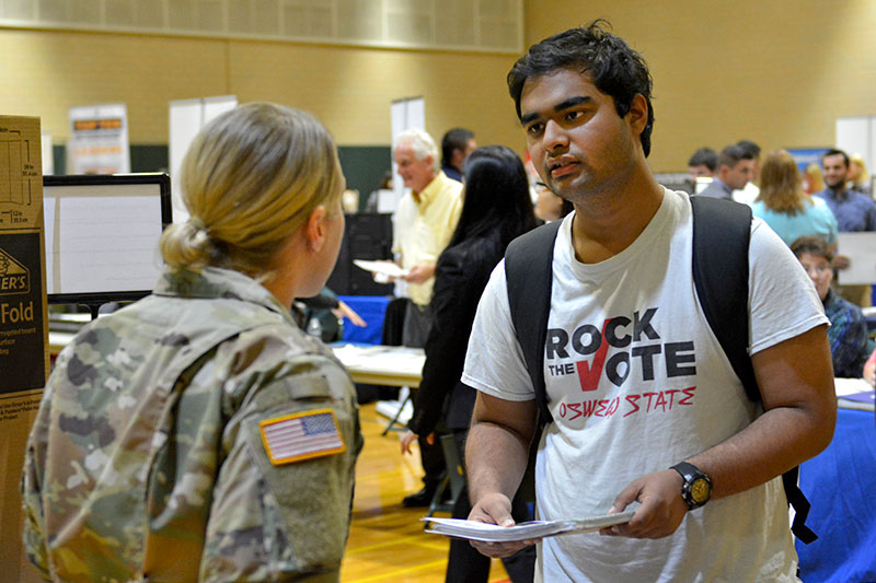 Shakhar Dasgupta speaks with Sgt. Erica Loucks of the New York Army National Guard during Career Fair