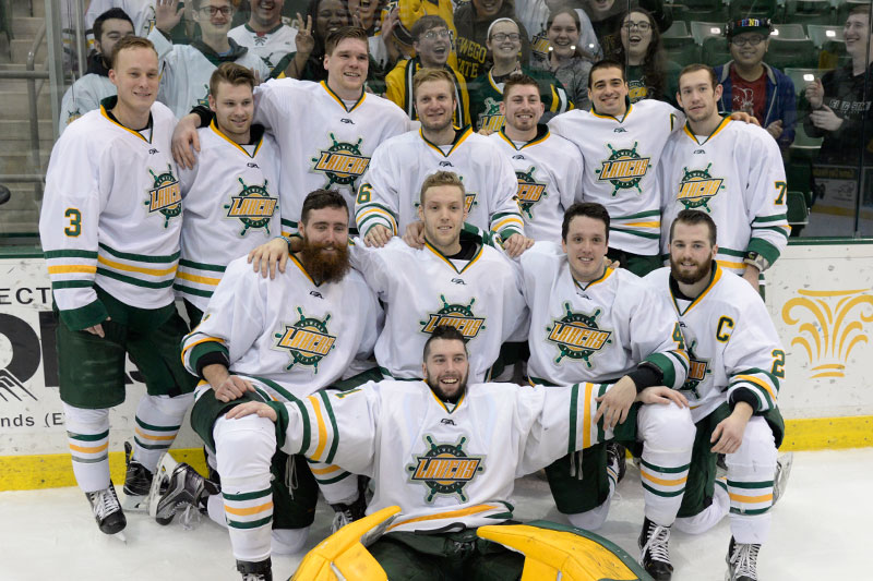 Laker men's hockey players celebrate